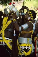 Female initiates wearing distinctive rituat attire comprised of alluminium belts and beaded bandoliers, Senegal