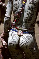 Maasai warrior with white chalk paste called 'enturoto' painted on his body, Kenya