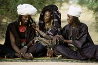 A Woodabe girl flirts with two men who may both become her lovers., Niger