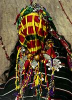 A Berber girl wears a traditional silk veil, along with the silver and amber jewelry of a virgin bride, Morocco