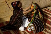 A Berber mother prepares her virgin daugter for marriage, Morocco