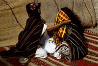 A Berber mother prepares her virgin daughter for marriage, Morocco