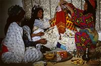 Female relatives prepare the bride for her marriage ceremony, Morocco