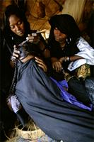 A fifteen-year-old Tuareg bride is prepared for her wedding, Niger