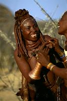 Himba girl, wearing coiled copper armlet which was given to her by her mother at puberty, Namibia