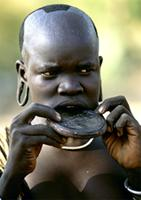 A Surma bride from Ethiopia wears a clay lip plate inserted six months before marriage, Ethiopia