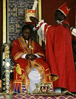The Kabaka, or King, of Buganda, Mutebi II, being crowned by the protestant Bishop at his Coronation ceremony. Baganda people, Kampala, Uganda.