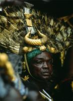 The Mponponsuohene, the Chief Sword Bearer of the Asantehene, King of Asante, with his elaborate headdress of eagle feathers and fine gold jewelry. 25th anniversary jubilee celebrations of Ghana's Asantehene, Opoku Ware II, Kumase, Ghana.