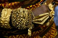 The Asantehenes King of Asante arms are heavily laden with fine