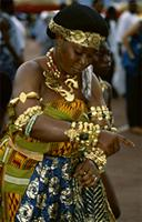 A female court dancer performs the Adowa, formerly a traditional funerary dance among the Asante and other Akan people. 25th anniversary jubilee celebrations of Ghana's Asantehene, Opoku Ware II, Kumase, Ghana