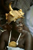 A Soul Washer with gold disk and special helmet. 25th anniversary jubilee celebrations of Ghana's Asantehene, Opoku Ware II, Kumase, Ghana