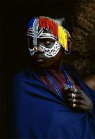 Dressed in dark blue, the newly circumcised girl wears a beaded band around her head signifying her new status, Kenya