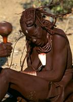 Himba woman receives healing from a Himba exorcist, Namibia