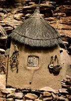 A Dogon granary hung with fetishes, Mali