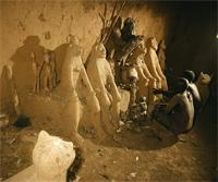 Private alter in a Lobi family compound, Upper Volta with pairs of ancestral figures moulded in local clay, Burkina Faso