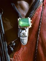 Pendant of a suitcase lock and imitation gemstone worn by a young Wodaabe man, Sahara