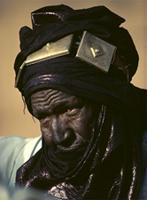 A Tuareg chief wearing a tagelmoust with three brass amulet boxes attached, Mali