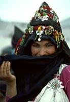 An Ait Hadiddu woman smiles shyly after receiving a wedding proposal, Morocco