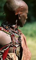 Maasai warrior wearing a brass coiled pendant, signifies his position as loosurutia, East Africa
