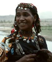 Woman from the Draa Valley with ornamented braids, southern Morocco