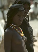 Young Afar nomad women wearing bright necklaces, Ethiopia