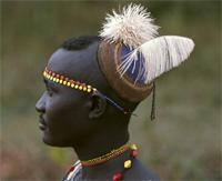 Pokot initiate of the coming-of-age ceremony wearing a blue skullcap, Kenya