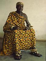 Nana Kwakye Ameyaw II, Paramount chief of Techiman in Bono State, Ghana, wears some of his officail regalia and a ceremonial Kente cloth