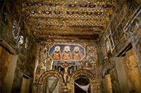 Inside the church of Derbe Berhan Selassie, with decorated canvases affixed directly on to the walls and ceiling, Ethiopia