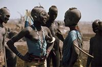 Dinka girls wearing beaded corsets, Sudan