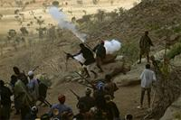 Male members of Dogon community firing their guns after death of elder, Mali