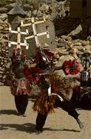 Kanaga masks dancing forcefully as they enter the village, Dogon people, Mali