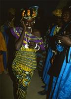 Fulani girl dancing at annual cattle river-crossing celebration, Mali
