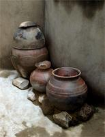 Kassena pottery and structures demonstrate Fao harvest ritual beliefs, Ghana