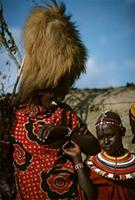 Adorned Maasai elder with girl.