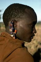 A Maasai adorned with earrings made from beads.