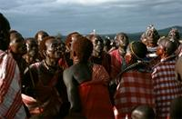 Maasai visitors to Alamal gathering arrive in song and carrying walking sticks.