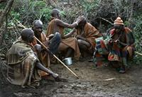 Maasai elders spending much of their time in quiet pursuits.