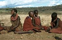 Adorned Maasai girls playing a game.