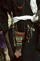 Woodabe wearing beautifully crafted knives, small spears, swords and leather purses, Niger.