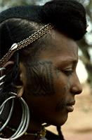 Intricate patterns on the cheeks of a Woodabe woman, Niger.
