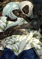 Male cousins displaying affection for one another, Woodabe people of Niger.
