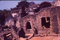 Kilwa Kisiwani: South part exterior. North end of West side, showing maro pillar (Mostly Southern part)
