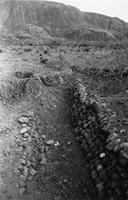 Stone revetted ditch/irrigation channel exposed by El Niño 1997/8 (later excavated as feature [1], see EN 02); Direction - North West