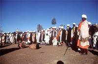 Priests gathered around ceremonial drums.