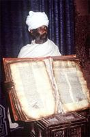 Priest in Lalibela exhibiting ancient Bible