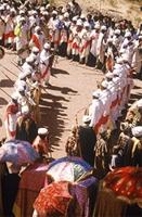 View from above of priests chanting and dancing.