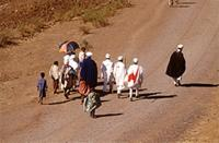 Priests and children walking