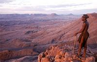 Himba man looking out over desert.