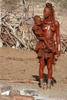 Himba woman with child.