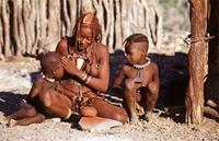 Himba woman with two children.